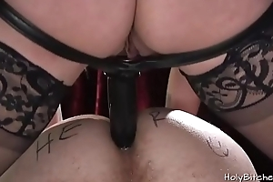 Voluptuous domina fucks her slave with a strapon