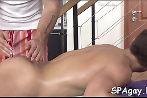Sexy hunk is property his pecker sucked unconnected with homoerotic kneading therapist