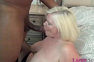 Busty grandma blows bank