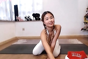 Amazing skinny Asian girl plays yoga
