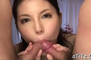 Asian spoil back lovely scoops gives magnetizing oral stimulation