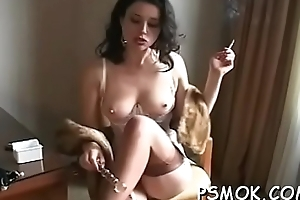 Prexy follower groupie playing with her titties whilst smoking a cigarette
